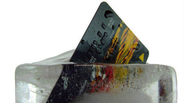 Image of a credit card on ice to represent post Christmas debt busting