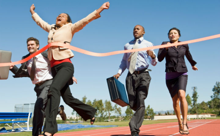 Young professionals crossing the finish line to symbolise a savings race